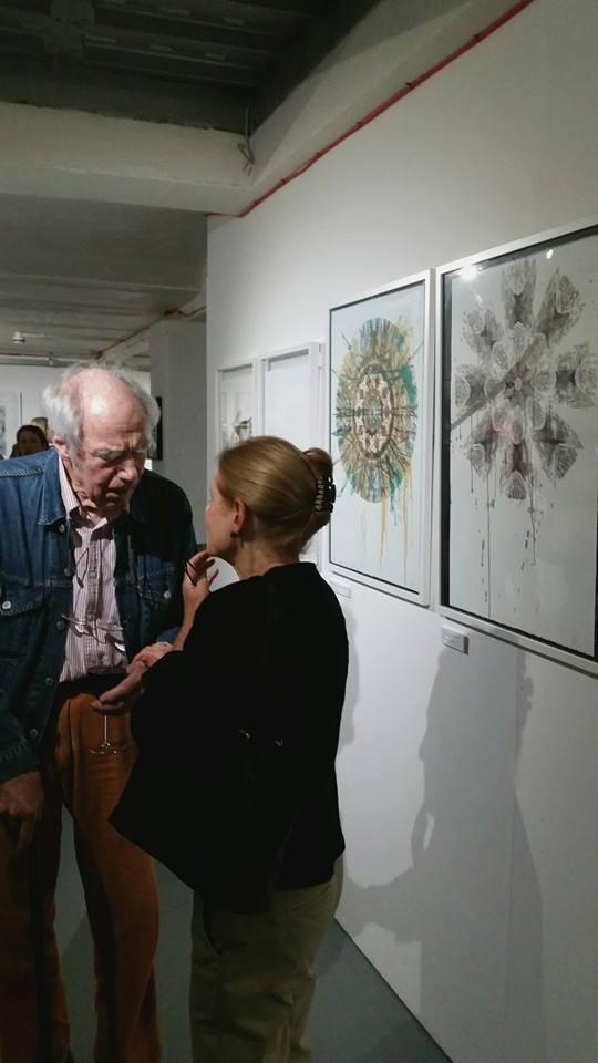 Artist Albert Irvin standing in front of my Mandalas