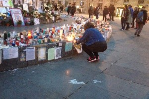 Me placing my print with the tributes at Place de la Republique
